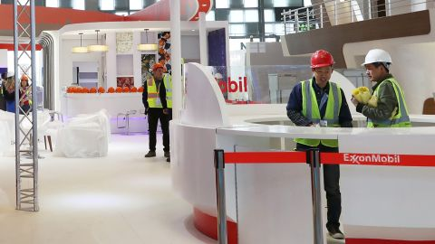 Workers are seen at the booth of ExxonMobil in preparation ahead of the International Conference & Exhibition on Liquefied Natural Gas (LNG2019) in Shanghai, China April 1, 2019. REUTERS/Stringer ATTENTION EDITORS - THIS IMAGE WAS PROVIDED BY A THIRD PARTY. CHINA OUT.