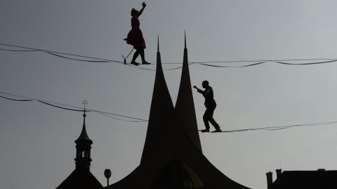 <strong>Prague: </strong>Tightrope artists are silhouetted on the skyline in front of the 14th-century Emmaus Monastery. The monastery is administrated by the Benedictine order.