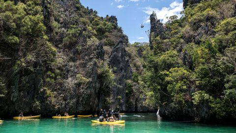 <strong>Palawan Philippines:</strong> On Miniloc Island, Briton Blake Aldridge dives from a precipice during the Red Bull Cliff Diving World Series held in April.
