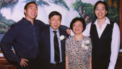 Yang, left, poses with his parents and brother. He studied economics and political science at Brown University and went to law school at Columbia University.