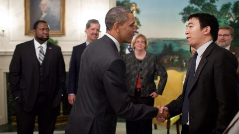 """Yang is greeted by President Barack Obama in a White House reception room in 2012. Yang was among those honored as a """"Champion of Change."""" He started Venture for America, a fellowship program that aims to connect recent college graduates with startups."""