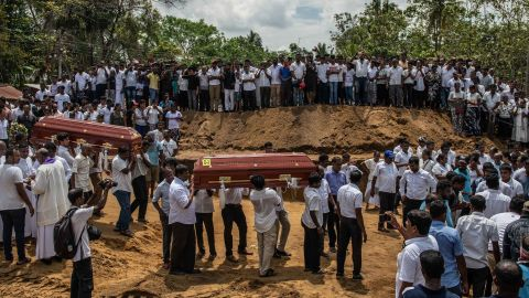 NEGOMBO, SRI LANKA - APRIL 23: Coffins are carried to a grave during a mass funeral at St Sebastian Church on April 23, 2019 in Negombo, Sri Lanka. At least 311 people were killed with hundreds more injured after coordinated attacks on churches and hotels on Easter Sunday rocked three churches and three luxury hotels in and around Colombo as well as at Batticaloa in Sri Lanka. Sri Lankan authorities declared a state of emergency on Monday as police arrested 24 people so far in connection with the suicide bombs, which injured at least 500 people as the blasts took place at churches in Colombo city as well as neighboring towns and hotels, including the Shangri-La, Kingsbury and Cinnamon Grand. (Photo by Carl Court/Getty Images)