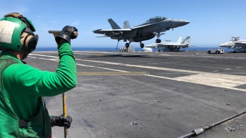 A US Navy F-18 Hornet shortly before landing on the deck of the USS Abraham Lincoln.
