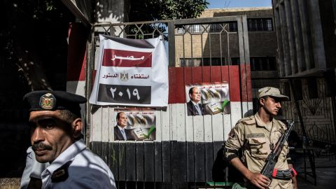 An Egyptian soldier and a policeman stand guard at a polling station in Cairo.