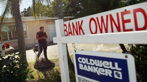 MIAMI, FL - NOVEMBER 10:  Renzo Salazar maintains the yard around a foreclosed home after the bank hired him to keep the home from falling into complete dilapidation on November 10, 2011 in Miami, Florida. RealtyTrac reported that foreclosures were up 7 percent in October from the prior month as defaults in California, Florida and Michigan hit 12-month highs.  (Photo by Joe Raedle/Getty Images)