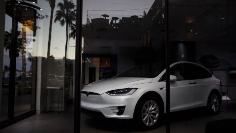 A Tesla Model X electric vehicle sits inside of a closed Tesla Inc. store in Palm Desert, California, U.S., on Thursday, March 7, 2019. Tesla has cut prices of the Model 3 and its other vehicles several times this year to offset the lower incentives, most recently by announcing a plan to close moststoresand shift all ordering online. Photographer: Patrick T. Fallon/Bloomberg via Getty Images