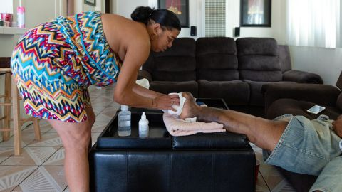 """Bernadette Moss is her husband's primary caregiver. """"If I didn't have my wife, I don't know where I'd be,"""" he said."""