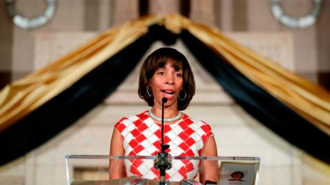 FILE - In this Dec. 6, 2016, file photo, Baltimore Mayor Catherine Pugh delivers an address during her inauguration ceremony inside the War Memorial Building in Baltimore. A spokesman for the embattled mayor of Baltimore says she'll return from her leave of absence as soon as her health allows. Spokesman James Bentley told The Baltimore Sun on Saturday, April 6, 2019, that Pugh's health is improving. It's unclear when she'll return. Pugh abruptly took her leave last week to recover from pneumonia. Meanwhile, a scandal involving her sale of children's books to high-profile clients has intensified.  (AP Photo/Patrick Semansky, File)