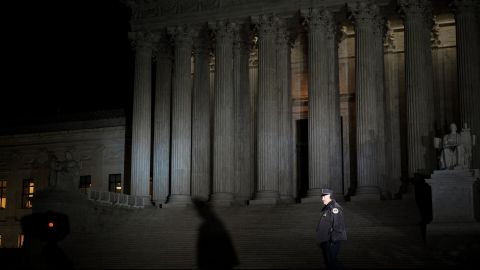WASHINGTON, DC - JANUARY 31: A Supreme Court Police officer patrols outside of the Supreme Court, January 31, 2017 in Washington, DC. President Donald Trump announced on Tuesday night that he intends to nominate Neil Gorsuch to the Supreme Court. Gorsuch is a U.S. Circuit Judge of the U.S. Court of Appeals for the Tenth Circuit. If confirmed, Gorsuch will take the seat that has been vacant since the February 2016 death of Justice Antonin Scalia. (Photo by Drew Angerer/Getty Images)