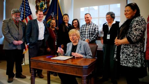 Maine Gov. Janet Mills signs a bill to establish Indigenous Peoples' Day, Friday, April 26, 2019, at the State House in Augusta, Maine.