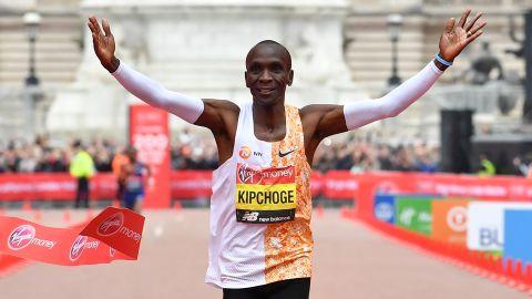 Kipchoge crosses the finish line to win the London Marathon.