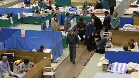 Akihito and Michiko visit an evacuation shelter after the earthquake and tsunami in 2011.
