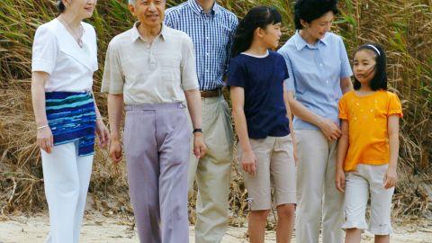 Akihito and Michiko walk on a beach in Shimoda, Japan, in 2004. Joining them were their son Fumihito and Fumihito's family: wife Kiko and daughters Mako and Kako.