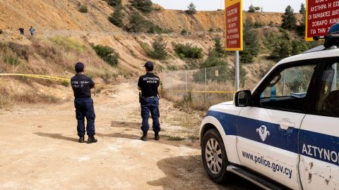 Cypriot forensic police cordon off a suspected dump site at Mitsero Red Lake on April 26, 2019.