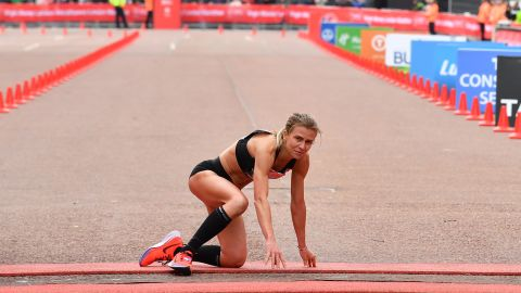 Hayley Carruthers hauls herself over the finish line