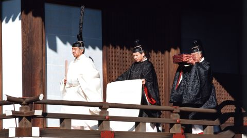 Akihito walks during his enthronement ceremony in 1990. A year and 10 months after the death of his father, Akihito officially became the 125th Emperor of Japan.