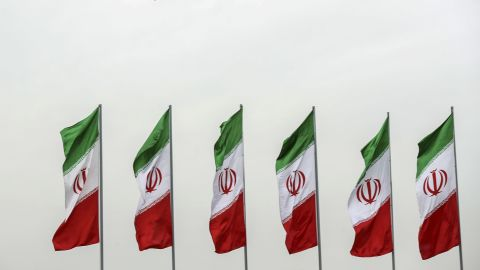 In this photo released by the official website of the office of the Iranian Presidency, a fighter jet flies over Iranian flags during the army parade commemorating National Army Day in front of the shrine of the late revolutionary founder Ayatollah Khomeini, just outside Tehran, Iran, Thursday, April 18, 2019. Iran showcased its domestically made fighter jets by flying the aircraft over Tehran during the parade Thursday as the country grapples with U.S. sanctions and the Trump administration's recent terrorism designation of Iran's powerful paramilitary force. (Iranian Presidency Office via AP)