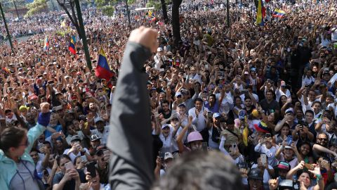 Lopez raises his fist to a crowd of supporters in Caracas on April 30. Lopez is meant to be on house arrest, but he said on Twitter that he was released by the military.