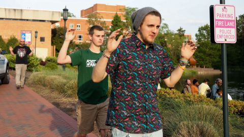 Students and faculty file out of buildings with their hands up during a lockdown after a shooting on the campus of University of North Carolina Charlotte in University City, Charlotte, on April 30, 2019. - Six people were shot, two of them died on the University of North Carolina Charlotte campus. One person was taken into custody, according to police sources. (Photo by Logan Cyrus / AFP)        (Photo credit should read LOGAN CYRUS/AFP/Getty Images)