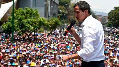 Venezuelan opposition leader Juan Guaido delivers a speech to supporters during a rally to commemorate May Day on May 1, 2019 (Photo by Federico PARRA / AFP)
