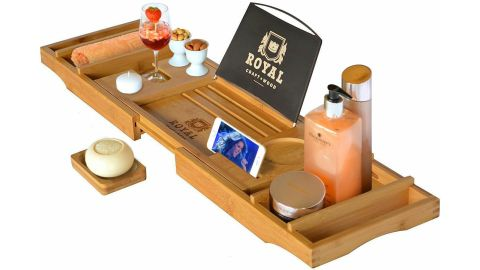 """<strong>Royal Craft Wood Luxury Bathtub Caddy Tray ($44.97; </strong><a href=""""https://amzn.to/2vzgS6R"""" target=""""_blank"""" target=""""_blank""""><strong>amazon.com</strong></a><strong>)</strong><br />This luxurious bathtub caddy can hold mom's wine glass, phone, book (or Kindle), snacks and anything else she needs to relax<br />"""
