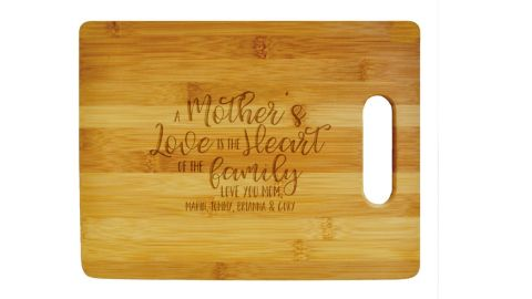 """<strong>904 Custom Personalized Mother's Day Cutting Board ($39.99; </strong><a href=""""https://amzn.to/2XXXqgn"""" target=""""_blank"""" target=""""_blank""""><strong>amazon.com</strong></a><strong>)</strong><br />Customize a cutting board with a sweet saying for mom to use for family meals<br /><br />"""