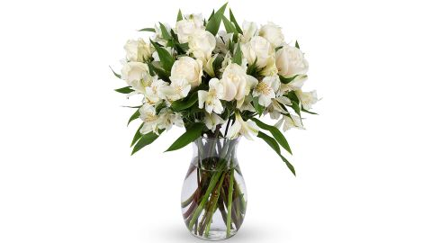 """<strong>Benchmark Bouquets Elegance Roses and Alstroemeria With Vase ($39.26; </strong><a href=""""https://amzn.to/2LhQw4d"""" target=""""_blank"""" target=""""_blank""""><strong>amazon.com</strong></a><strong>)</strong><br />Fresh flowers are always a good idea on Mother's Day and these are too pretty to pass up<br />"""