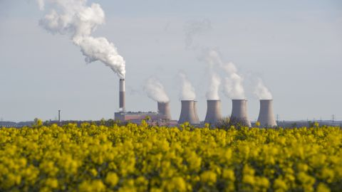 Smoke rises from the cooling towers of Cottam coal-fired power station, owned by EDF, in east England on April 17, 2015.