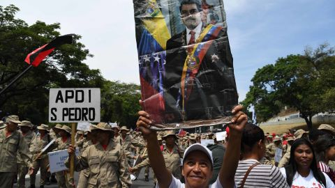 A Maduro supporter displays a poster of him during a rally on May 1.