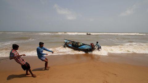 Fishing boats at Konark Beach prepare this week for Tropical Cyclone Fani in eastern India's Odisha.