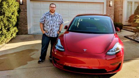 Nick Schwab with his Tesla Model 3.