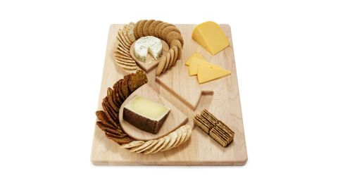 """Cheese & Crackers Serving Board ($48; <a href=""""https://www.uncommongoods.com/product/cheese-crackers-serving-board"""" target=""""_blank"""" target=""""_blank"""">uncommongoods.com</a>)"""