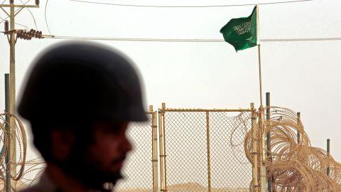 The flag of Saudi Arabia flies at a border crossing.