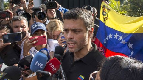 """Opposition activist Leopoldo Lopez <a href=""""https://edition.cnn.com/2019/05/03/americas/venezuela-lopez-opposition-intl/index.html"""" target=""""_blank"""">speaks to the media</a> at the gate of the Spanish ambassador's residence in Caracas on May 2. Lopez is meant to be on house arrest, but he said on Twitter that he was released by the military. He and his family have been received as guests by Spanish Ambassador Jesús Silva Fernández following his release."""
