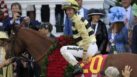 LOUISVILLE, KENTUCKY - MAY 04: Jockey Flavien Prat celebrates atop of Country House #20 after winning the 145th running of the Kentucky Derby at Churchill Downs on May 04, 2019 in Louisville, Kentucky. (Photo by Andy Lyons/Getty Images)