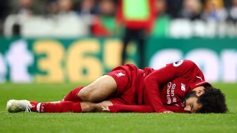Mohamed Salah of Liverpool goes down injured during win at Newcastle.