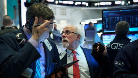 Traders and financial professionals work at the opening bell on the floor of the New York Stock Exchange (NYSE), May 6, 2019 in New York City. The Dow Jones Industrial Average dropped over 360 points at the open on Monday morning after U.S. President Donald Trump said that the U.S. will raise tariffs on goods imported from China.