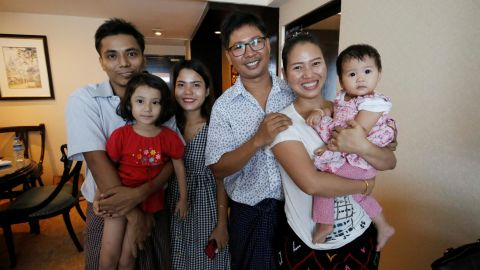 Wa Lone poses with his wife Pan Ei Mon and daughter, along with fellow reporter, Kyaw Soe Oo, carrying his daughter, next to wife Chit Su Win.