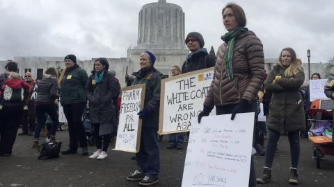Hundreds of people, including families, attend a rally at the Oregon State Capitol protesting a proposal to tighten school vaccine requirements Thursday, March, 7, 2019, in Salem, Oregon.