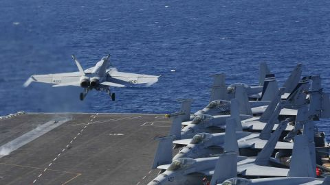"""In this May 3, 2019 photo released by the U.S. Navy, An F/A-18E Super Hornet from VFA 25 launches from the flight deck of the Nimitz-class aircraft carrier USS Abraham Lincoln. The U.S. is dispatching the USS Abraham Lincoln and other military resources to the Middle East following """"clear indications"""" that Iran and its proxy forces were preparing to possibly attack U.S. forces in the region, according to a defense official on May 5, 2019. (Mass Communication Specialist Seaman Michael Singley/US Navy via AP)"""