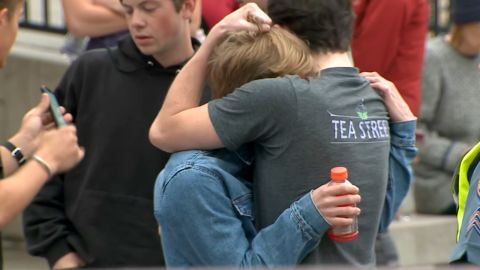 A community grieves after a mass shooting at the STEM School Highlands Ranch.