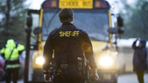 HIGHLANDS RANCH, CO - MAY 07: A sheriff's officer watches as students get off buses after being evacuated to the Recreation Center at Northridge after at least seven students were injured during a shooting at STEM School Highlands Ranch on May 7, 2019 in Highlands Ranch, Colorado. (Photo by Michael Ciaglo/Getty Images)