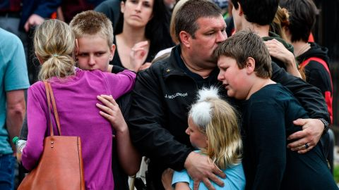Parents reunite with children evacuated from STEM School Highlands Ranch after a shooting at the school.