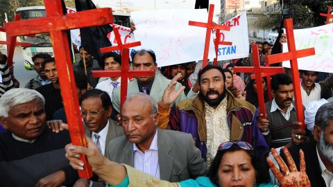 Members of the Pakistan Christian Democratic alliance march during a protest in Lahore on December 25, 2010, in support of Asia Bibi.