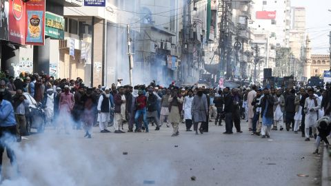 Pakistani Islamists react after the police use tear gas during a protest against the Supreme Court decision on Asia Bibi's case.