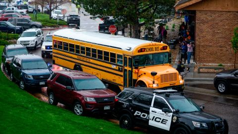 HIGHLANDS RANCH, CO - MAY 07: A bus evacuating students arrives at the Recreation Center at Northridge after at least seven students were injured during a shooting at STEM School Highlands Ranch on May 7, 2019 in Highlands Ranch, Colorado. (Photo by Michael Ciaglo/Getty Images)