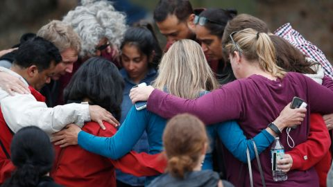 Parents gather in a circle to pray at a recreation center where students were reunited with their parents after a shooting at a suburban Denver middle school Tuesday, May 7, 2019, in Highlands Ranch, Colo. (AP Photo/David Zalubowski)