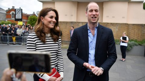 Harry's brother, Prince William, and William's wife Catherine, the Duchess of Cambridge, talk to the media about their new nephew on Tuesday, May 7.