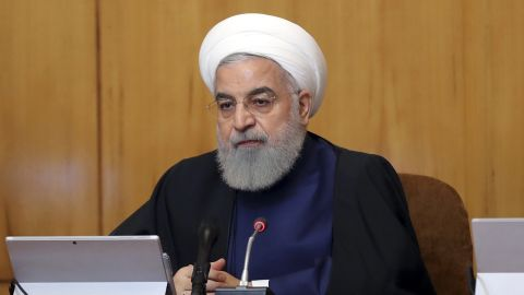 In this photo released by the official website of the office of the Iranian Presidency, President Hassan Rouhani heads a cabinet meeting in Tehran, Iran, Wednesday, May 8, 2019. Rouhani said Wednesday that it will begin keeping its excess uranium and heavy water from its nuclear program, setting a 60-day deadline for new terms to its nuclear deal with world powers before it will resume higher uranium enrichment. (Iranian Presidency Office via AP)