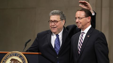 U.S. Attorney General William Barr jokes with Deputy Attorney General Rod Rosenstein on May 09, 2019 in Washington, DC. (Photo by Chip Somodevilla/Getty Images)